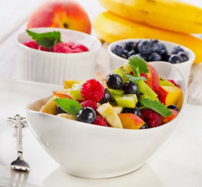 Fresh healthy fruit salad with mint . Selective focus